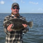 a rockport fisherman with a flounder