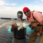 two fisherman showing a redfish caught on light tackle