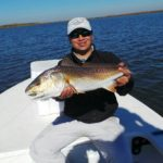 a fisherman showing a nice redfish