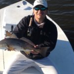 a fly fisherman showing a redfish